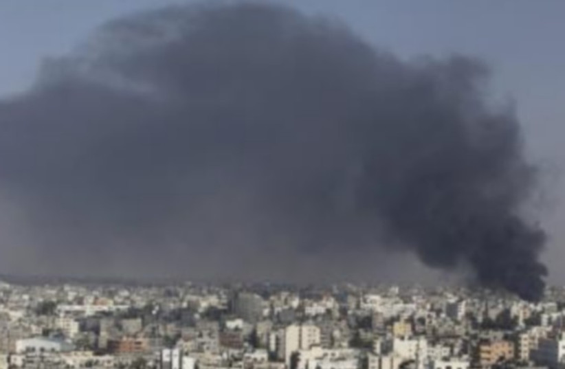 Smoke rises following what witnesses said was an IAF air strike in the east of Gaza City. (photo credit: REUTERS)