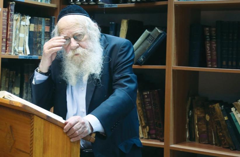 Rabbi Adin Steinsaltz stands in the library of his yeshiva in Jerusalem's Nahlaot neighborhood. (photo credit: MARC ISRAEL SELLEM/THE JERUSALEM POST)
