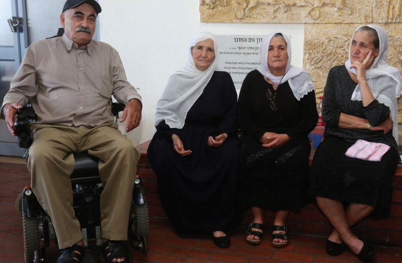 Najib and Yammi wait to see their wounded officer son along with relatives (photo credit: MARC ISRAEL SELLEM)