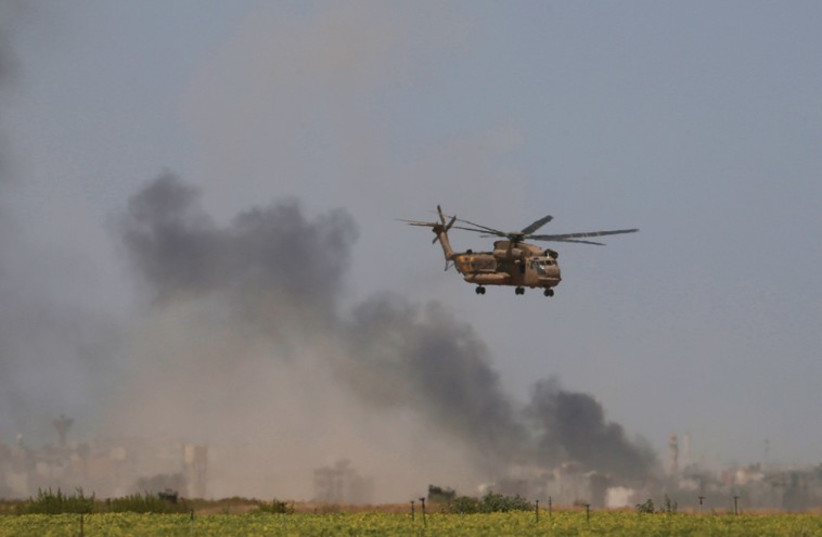 A HELICOPTER evacuates wounded from Gaza to a hospital. (photo credit: REUTERS)