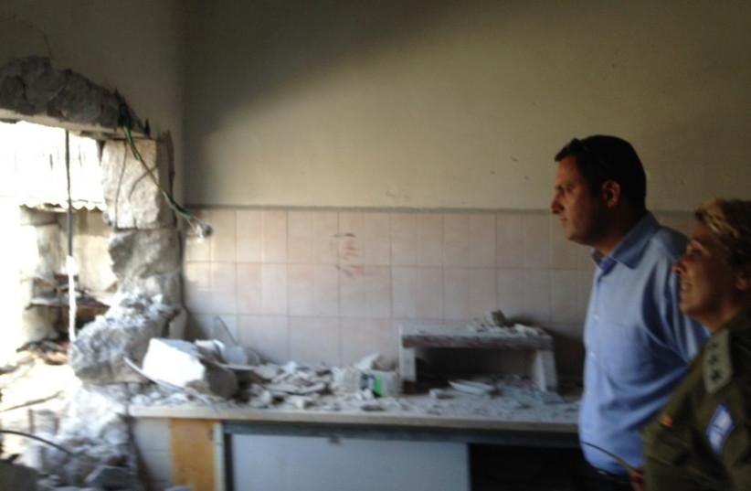 Sderot Mayor Alon Davidi with soldier in damaged building in 2014. (photo credit: Courtesy)