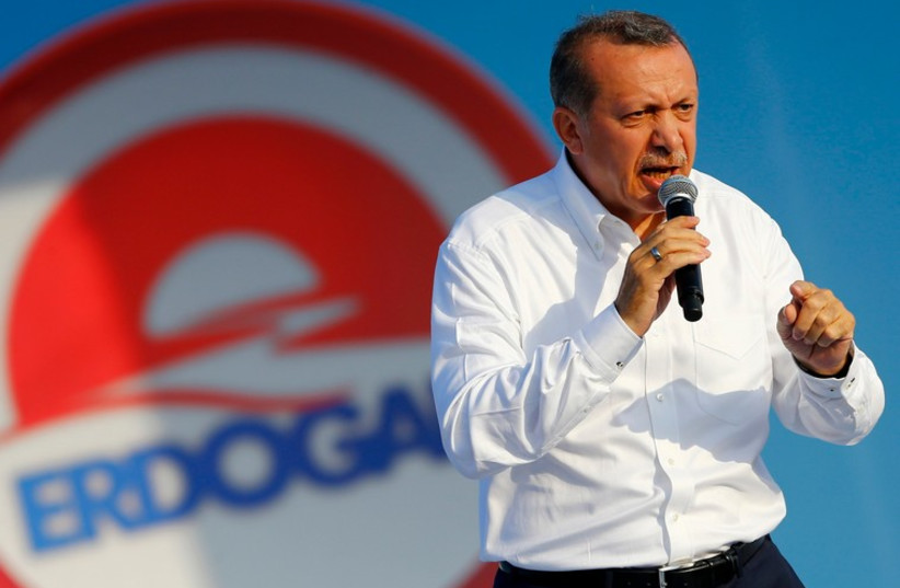 Turkey's Prime Minister and presidential candidate Tayyip Erdogan addresses his supporters during an election rally in Istanbul August 3, 2014. (photo credit: REUTERS)