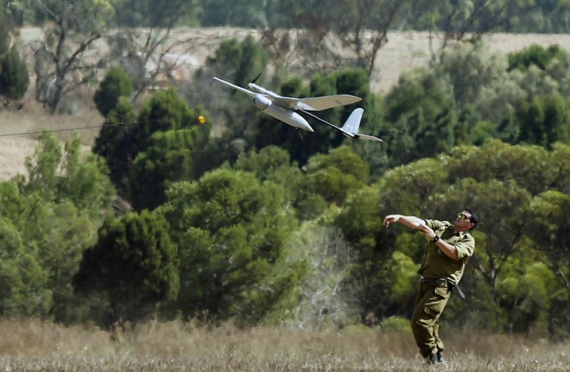 An Israeli soldier launches a Skylark unmanned aerial vehicle near the border with Gaza Strip (photo credit: REUTERS)