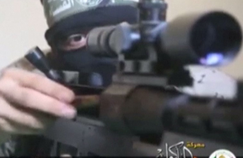 Hamas' armed wing, releases video it says shows fighters using a Hamas-made sniper rifle to shoot Israeli soldiers. (photo credit: screenshot)