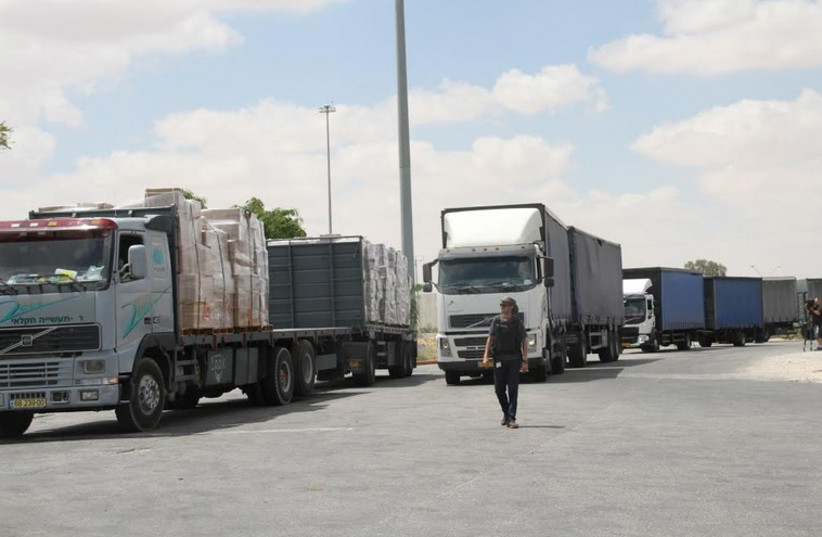 ISRAELI TRUCKS head into the Kerem Shalom crossing point yesterday with goods bound for the Gaza Strip (photo credit: TOVAH LAZAROFF)