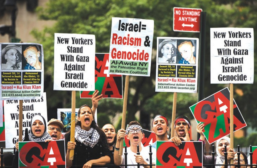 Anti-Israel demonstrators stage a rally outside New York City Hall (photo credit: LUCAS JACKSON / REUTERS)