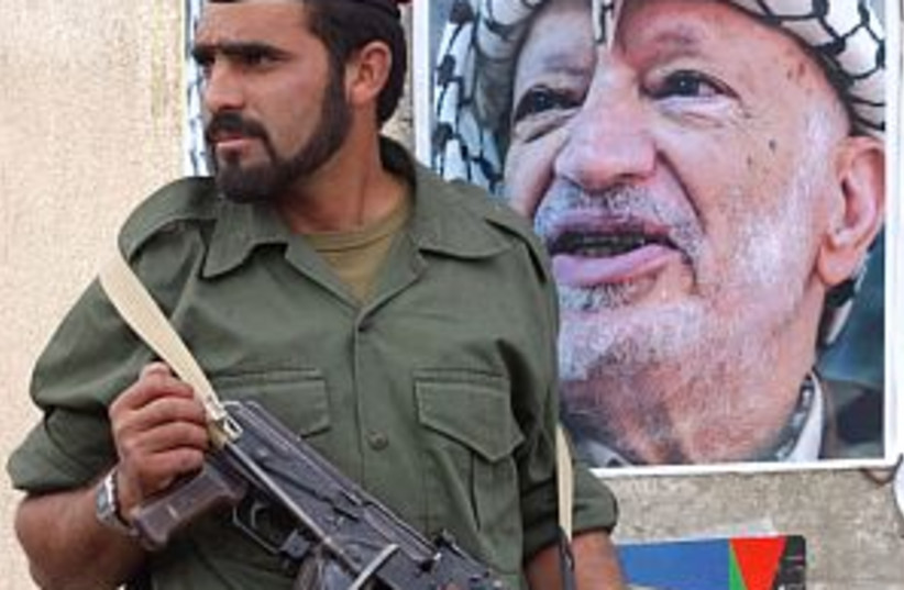 arafat posters wall 298 (photo credit: Ariel Jerozolimski)
