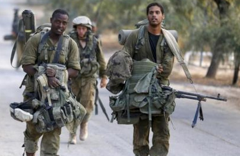 IDF soldiers after returning to Israel from Gaza August 5, 2014. (photo credit: REUTERS)
