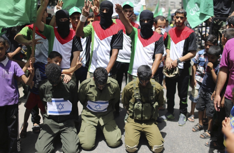 Hamas supporters reenact kidnapping of Israeli soldiers (photo credit: REUTERS)