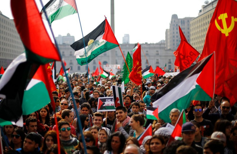 Supporters and members of the Palestine community attend a rally for peace in Gaza, in Santiago, August 9, 2014. (photo credit: REUTERS)