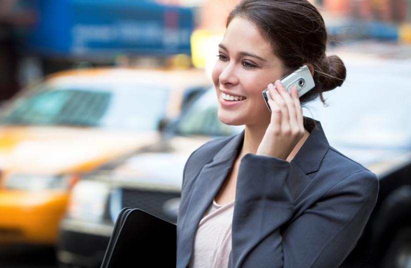 Woman talks on the phone (Illustrative photo) (photo credit: INGIMAGE / ASAP)