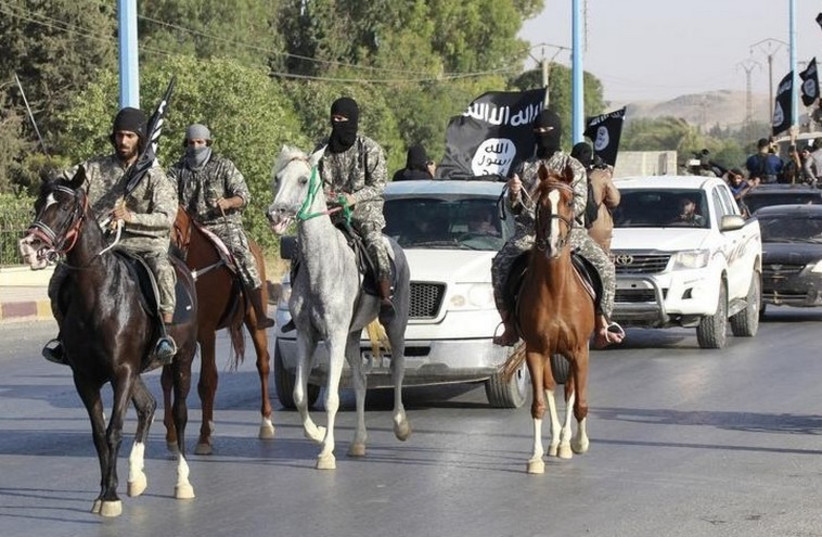 Islamic State militants parade in Mosul (photo credit: REUTERS)