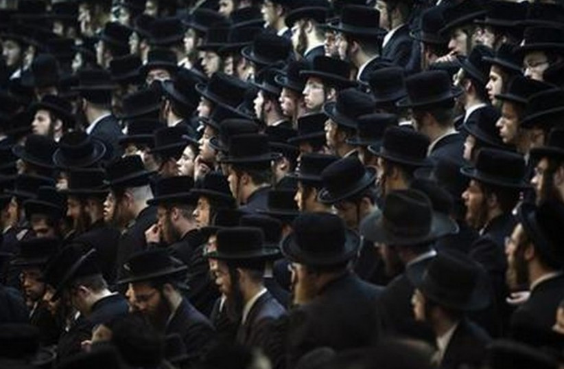 Ultra-Orthodox man take part in a rally in Bnei Brak. (photo credit: REUTERS)