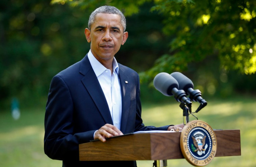 US President Barack Obama delivers a statement on the situation in Iraq from his vacation home at Martha's Vineyard, Massachusetts. (photo credit: REUTERS)