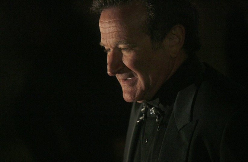 Actor Robin Williams arrives at singer-songwriter Elton John's 60th birthday party in New York  (photo credit: REUTERS)