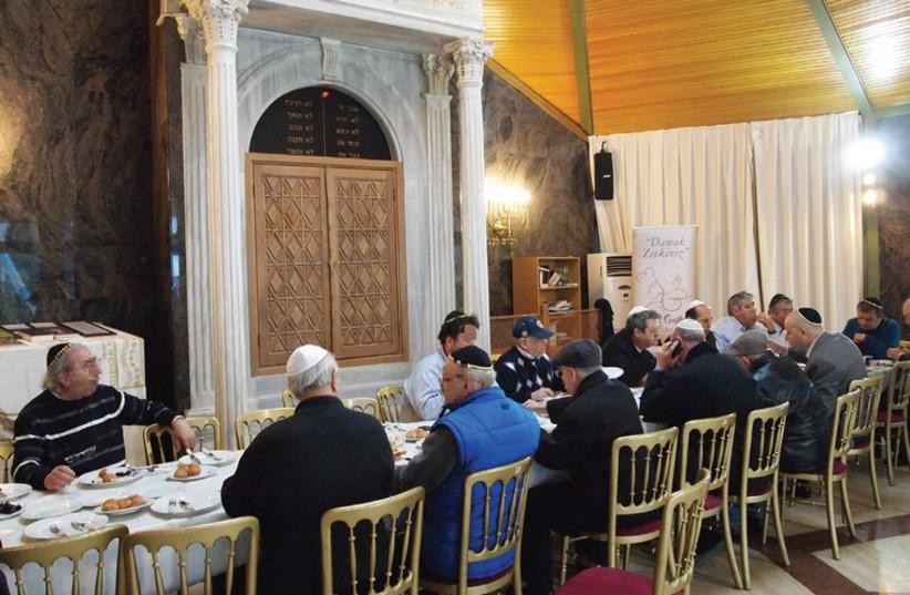 Turkish Jews eating breakfast in an Istanbul synagogue (photo credit: SAM SOKOL)