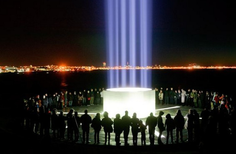 The Imagine Peace Tower lit in the hopes of bringing peace to the Israeli-Arab conflict (photo credit: GRAY LINE ICELAND)