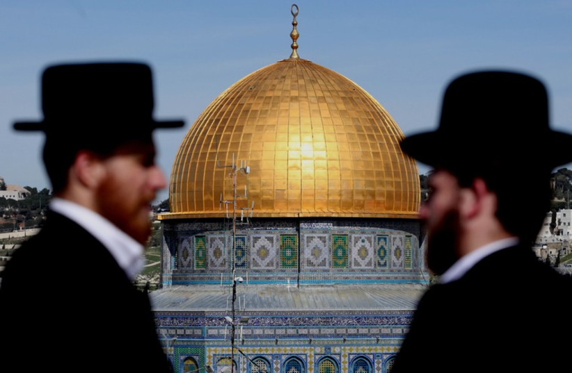 Two men overlook the Temple Mount's Dome of the Rock from a distance. (photo credit: MARC ISRAEL SELLEM)