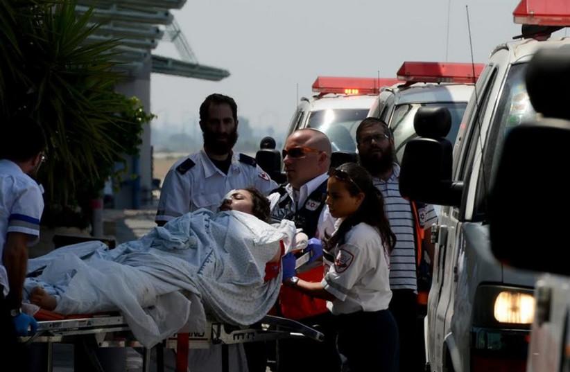 MDA crews evacuate wounded Palestinian from Gaza to Ben-Gurion Airoport for medical evacuation to Turkey.  (photo credit: KOBI GIDEON/GPO)