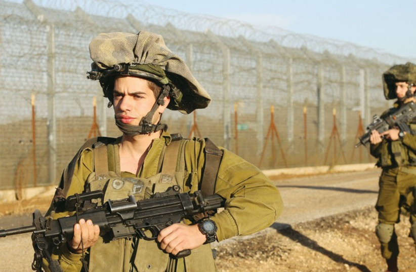 IDF soldiers patrol along the Syrian border in 2013. (photo credit: MARC ISRAEL SELLEM/THE JERUSALEM POST)