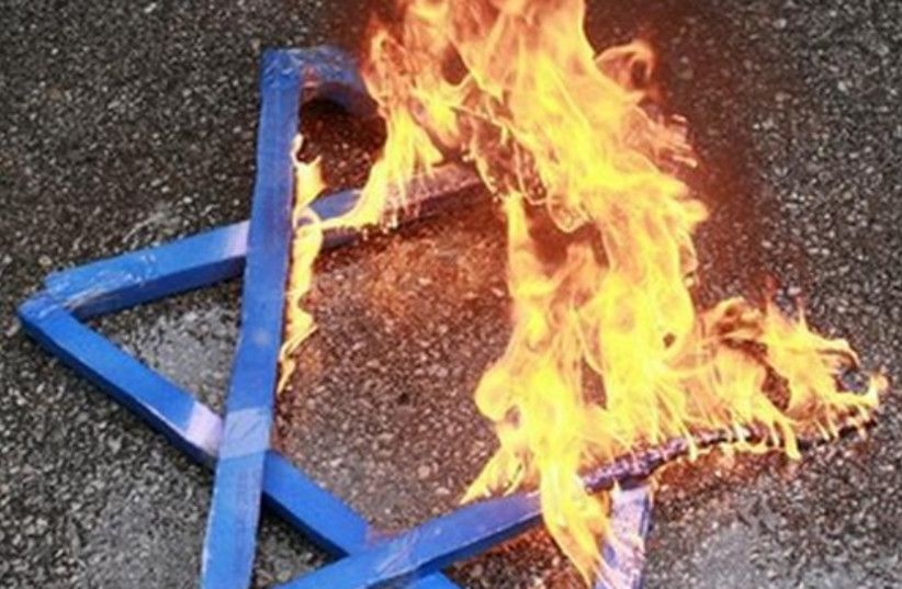 A Star of David burns in flames. (photo credit: REUTERS)