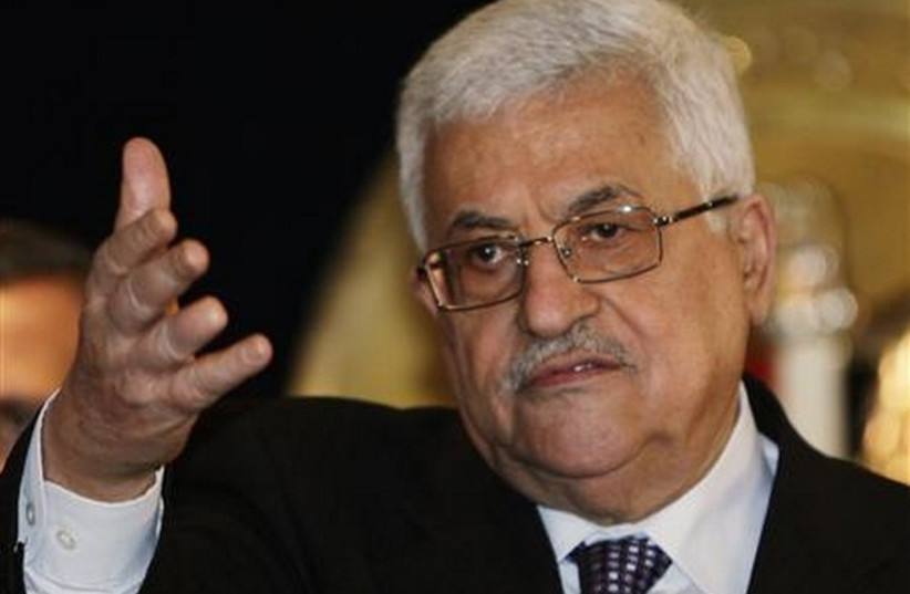 Palestinian Authority President Mahmoud Abbas talks during a news conference in Egypt (photo credit: REUTERS)