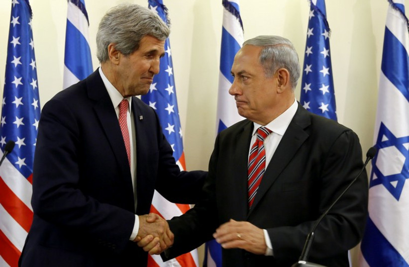 Prime Minister Benjamin Netanyahu (R) shakes hands with US Secretary of State John Kerry (photo credit: REUTERS)