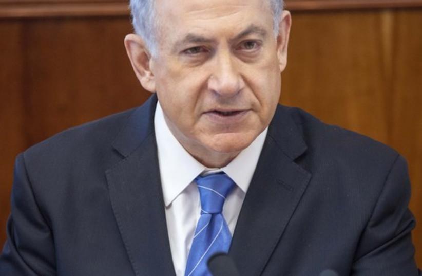 Netanyahu at cabinet meeting (photo credit: EMIL SALMAN/POOL)