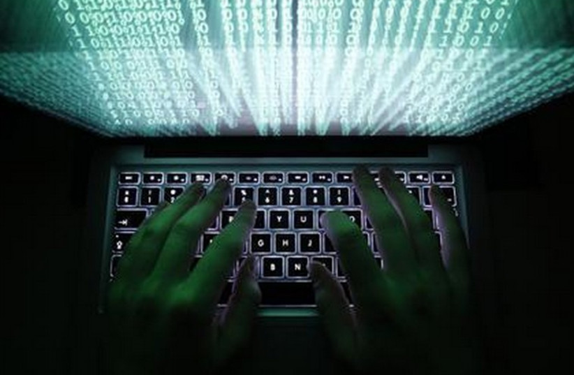 Cyber hackers [illustrative] (photo credit: REUTERS)