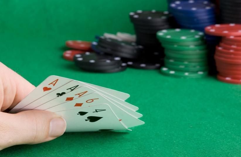 Poker game  (photo credit: INGIMAGE / ASAP)