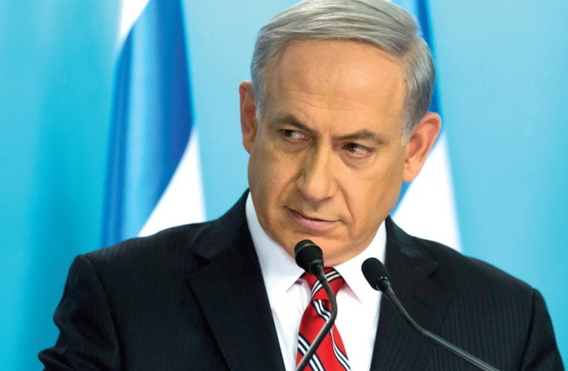 Prime Minister Benjamin Netanyahu holds a news conference at his office in Jerusalem, August 6. (photo credit: REUTERS)