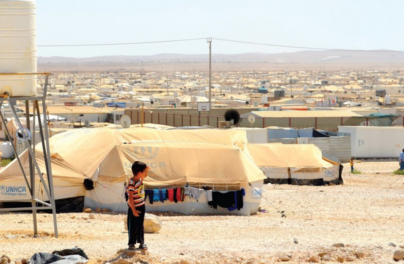 Zaatari refugee camp with Syria in the distance. (photo credit: MICHAEL WILNER)