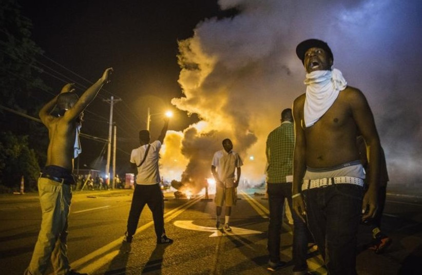 US protests over police shooting of unarmed black teen (photo credit: REUTERS)