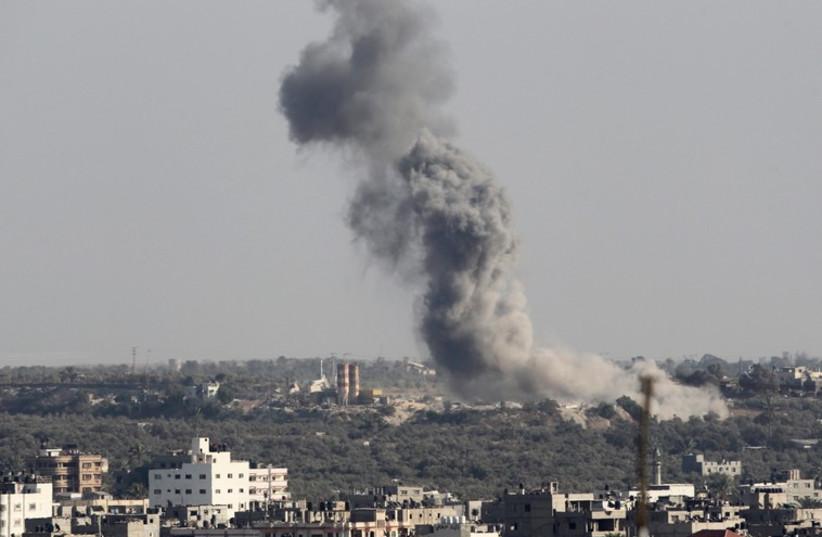 Smoke rises following Israeli air strike in Gaza August 19 (photo credit: REUTERS)