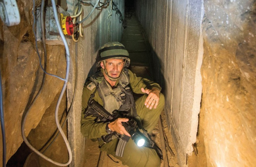 AN ISRAELI army officer explains to journalists how Hamas built tunnels to attack the country. (photo credit: REUTERS)