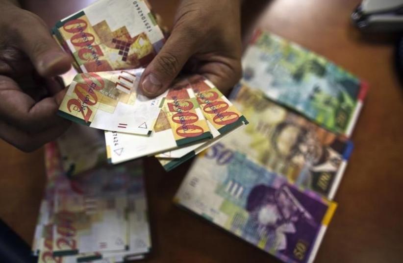 Shekel money bills (photo credit: REUTERS)