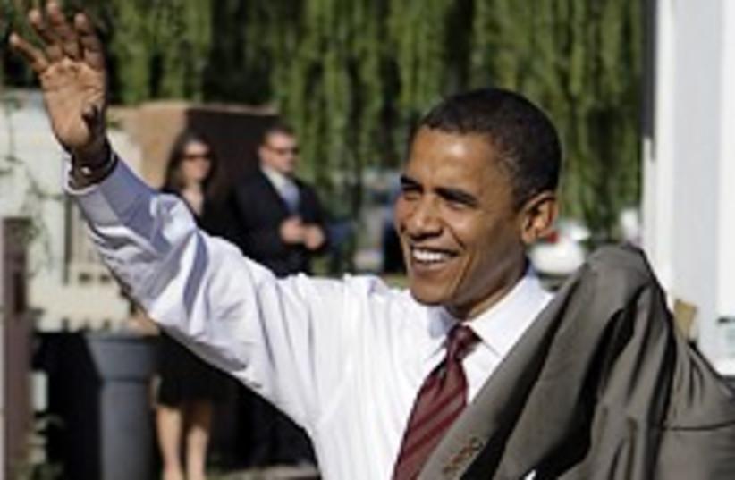 Obama smiles and waves 224.88 (photo credit: AP)