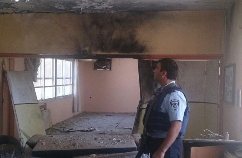 Police surveying damage of building in Eshkol, August 21, 2014. (photo credit: ISRAEL POLICE)