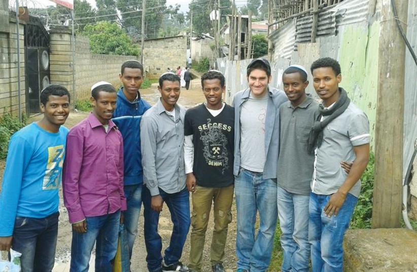 Uri Perednik poses with Ethiopian Jews in Addis Ababa. (photo credit: Courtesy)
