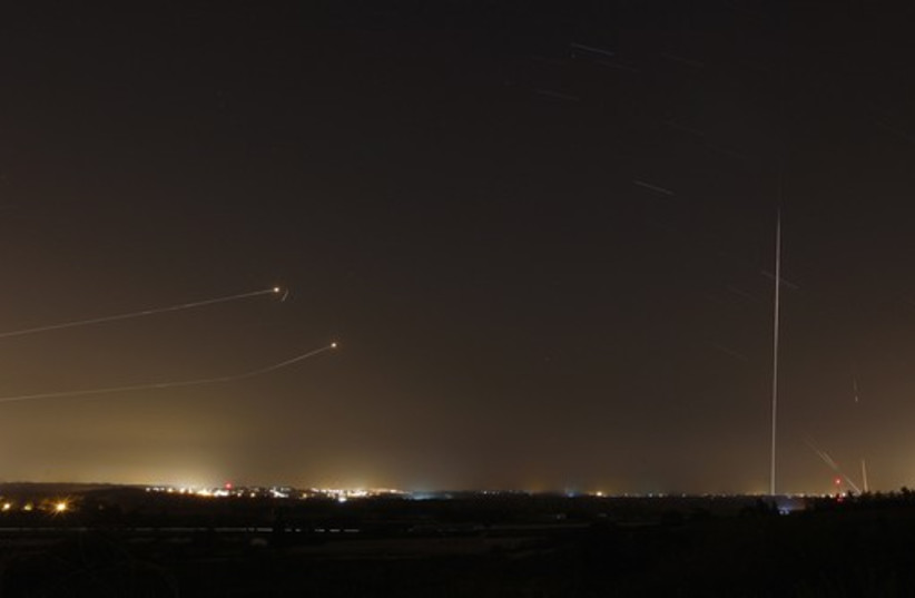 Rockets launched from Gaza Strip towards Israel is seen as rocket by Iron Dome anti-missile system is fired to intercept them (photo credit: REUTERS)