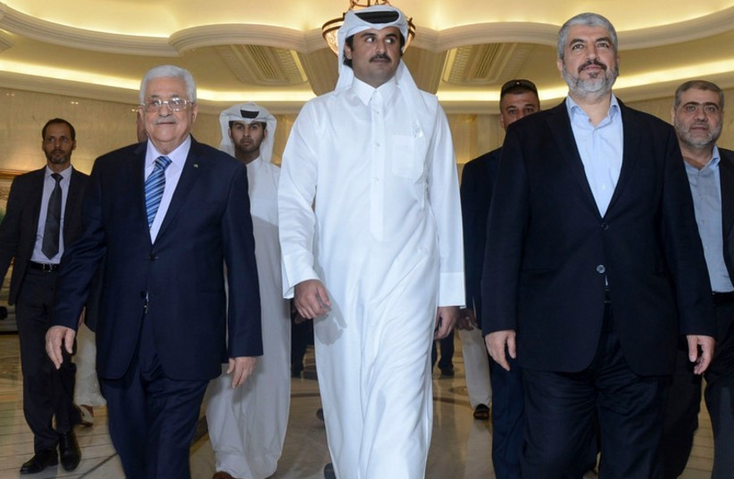 (L R) Palestinian Authority President Mahmoud Abbas, Emir of Qatar Sheikh Tamim bin Hamad al-Thani and exiled Hamas leader Khaled Mashaal arrive for a meeting in Doha. (photo credit: REUTERS)