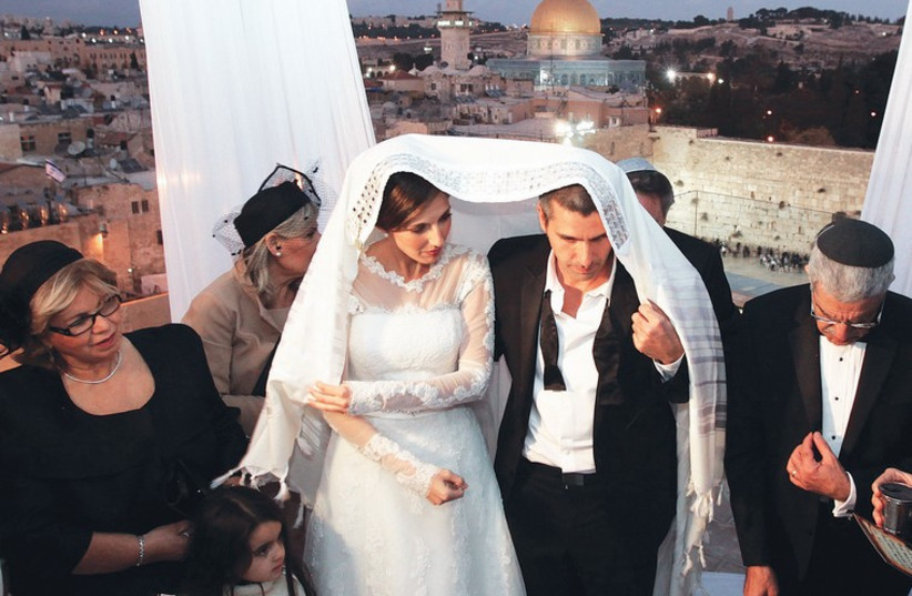 A Jewish couple weds in Jerusalem.  (photo credit: MARC ISRAEL SELLEM/THE JERUSALEM POST)