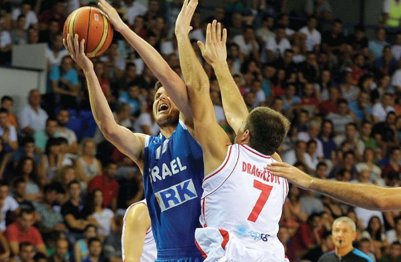 ISRAELI FORWARD Guy Pnini (with ball) continued his strong play for the national team, netting 12 points in Wednesday night's 80-65 win over Montenegro in Podgorica. (photo credit: SASHA MATIC)