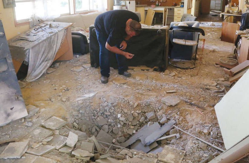 A MORTAR SHELL created this crater in the middle of an alternative medicine center in the Eshkol regional council. (photo credit: MARC ISRAEL SELLEM)