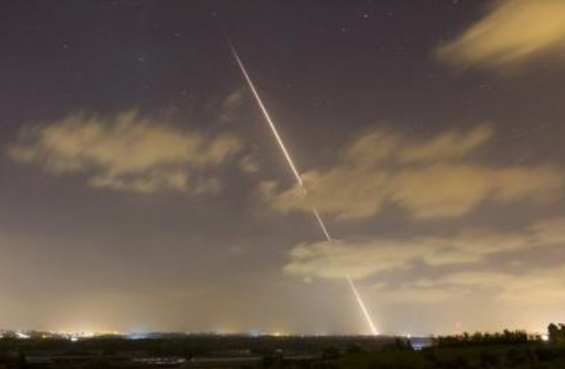 A rocket is launched from the northern Gaza Strip towards Israel. (photo credit: REUTERS)