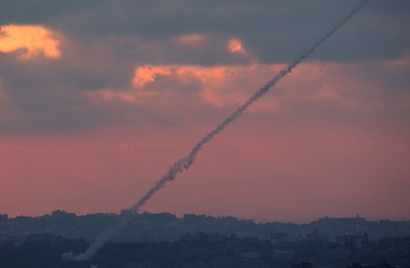 Smoke trails are seen as rockets are launched from the Gaza Strip towards Israel. (photo credit: REUTERS)