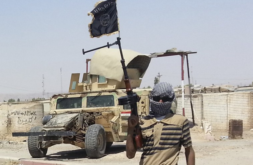 ISIS fighter (photo credit: REUTERS)
