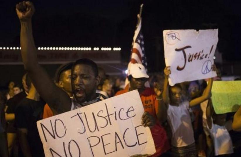 Demonstrators protest against police shooting of black teen in Ferguson, Missouri. (photo credit: REUTERS)