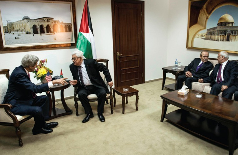US SECRETARY of State John Kerry and Palestinian Authority President Mahmoud Abbas talk while PLO Executive Committee member Yasser Abed Rabbo and Palestinian negotiator Saeb Erekat talk on the side during a meeting at the presidential compound in Ramallah. (photo credit: REUTERS)