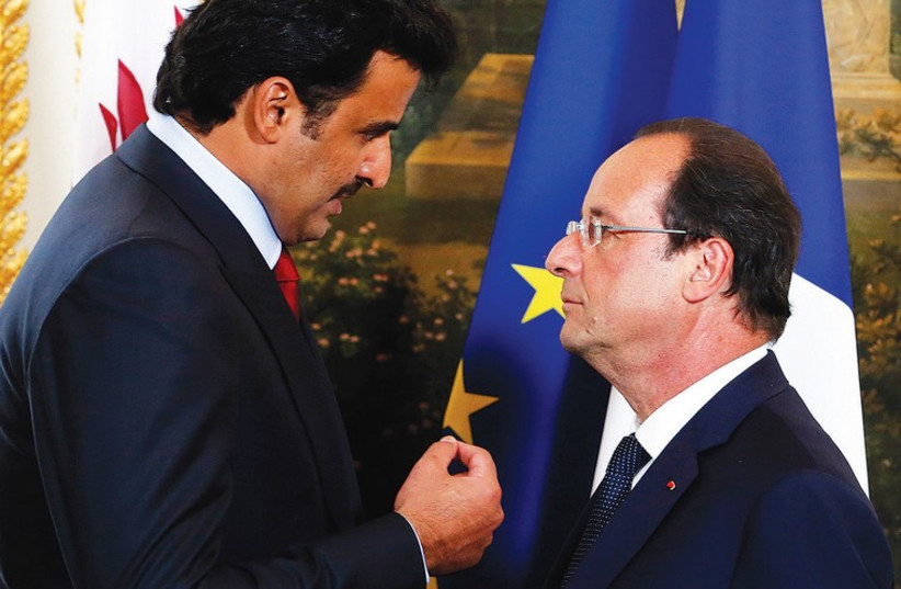 FRENCH PRESIDENT Francois Hollande (R) and Qatar's Sheikh Tamim bin Hamad al-Thani at the Elysee Palace in Paris. (photo credit: REUTERS)